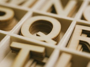 Wood letters in a wood box